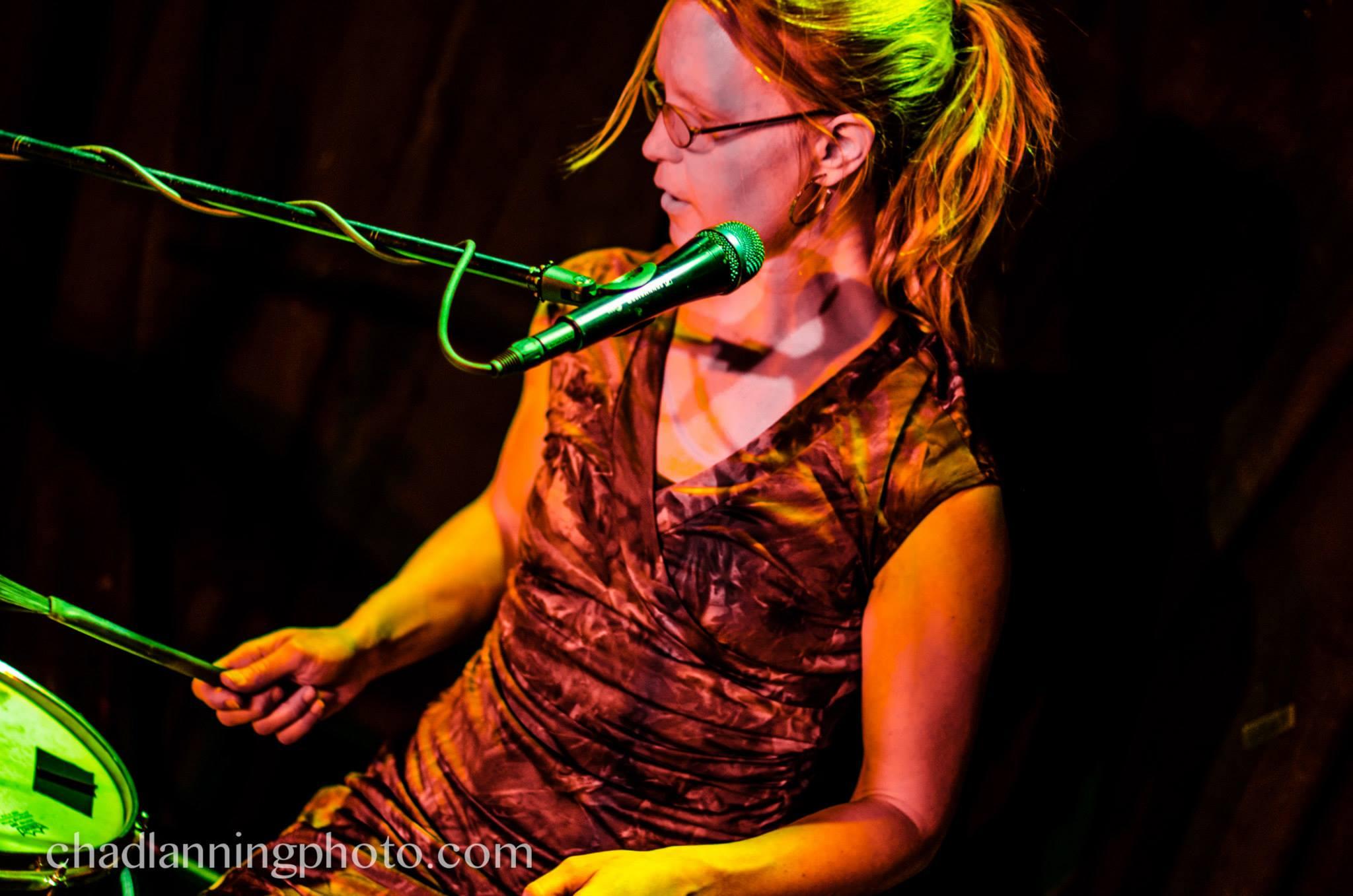Juniana Lanning playing drum set (photo by Chad Lanning)