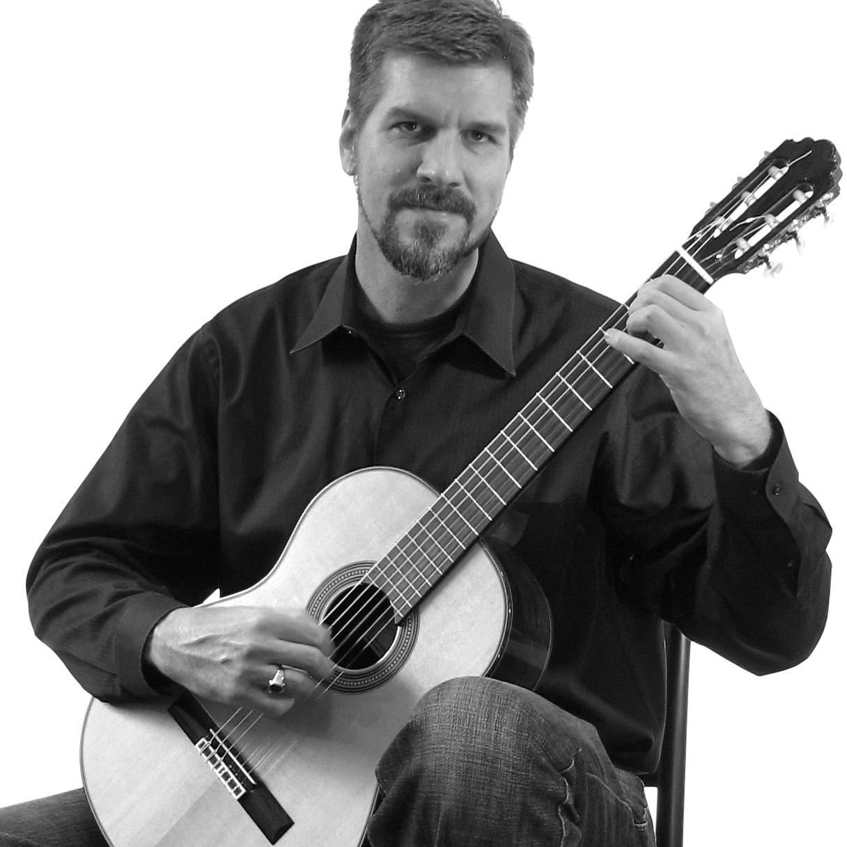 Mark Bussey,  guitar