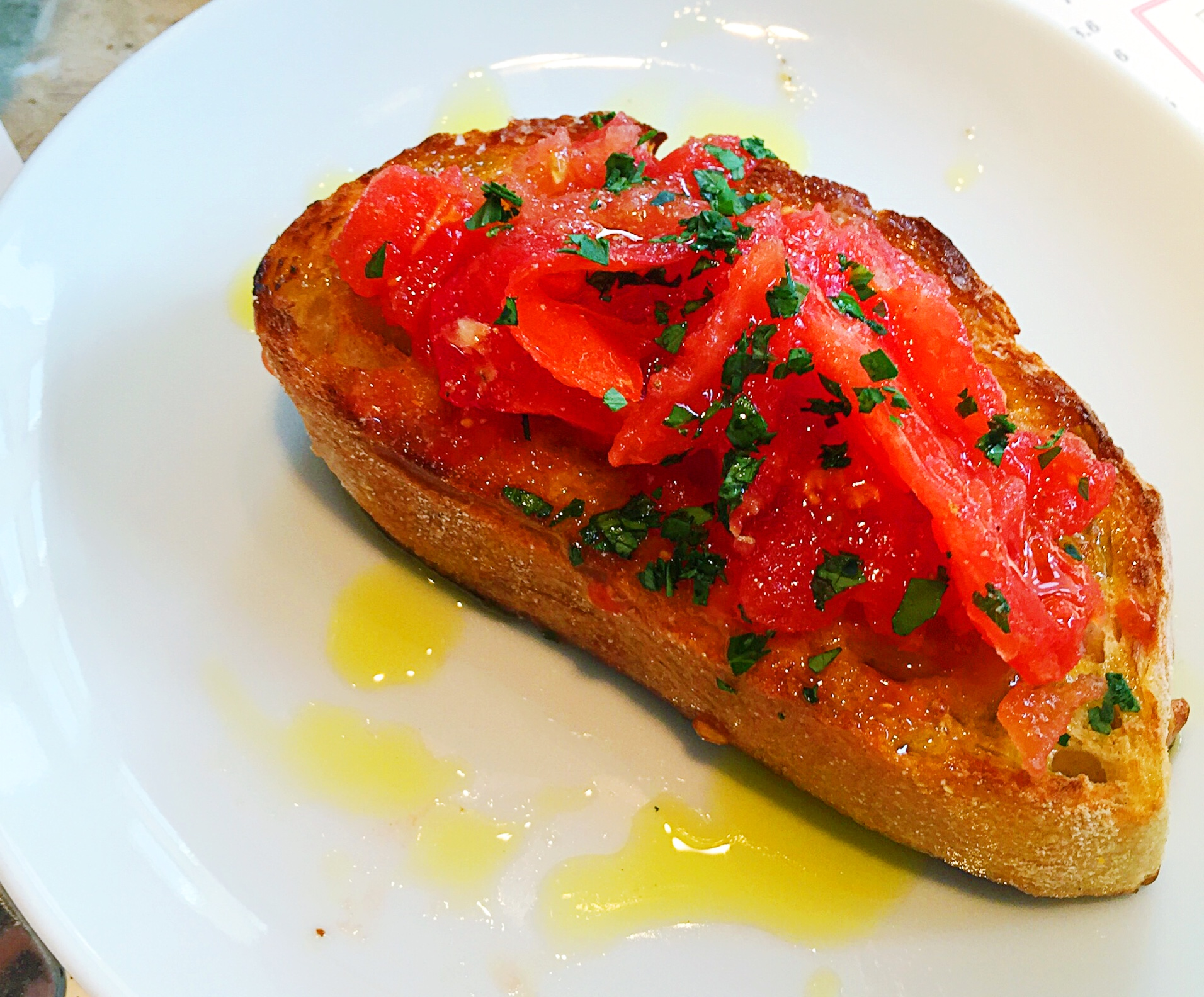 Pan con tomate - don't be shy with the olive oil or the salt on this...