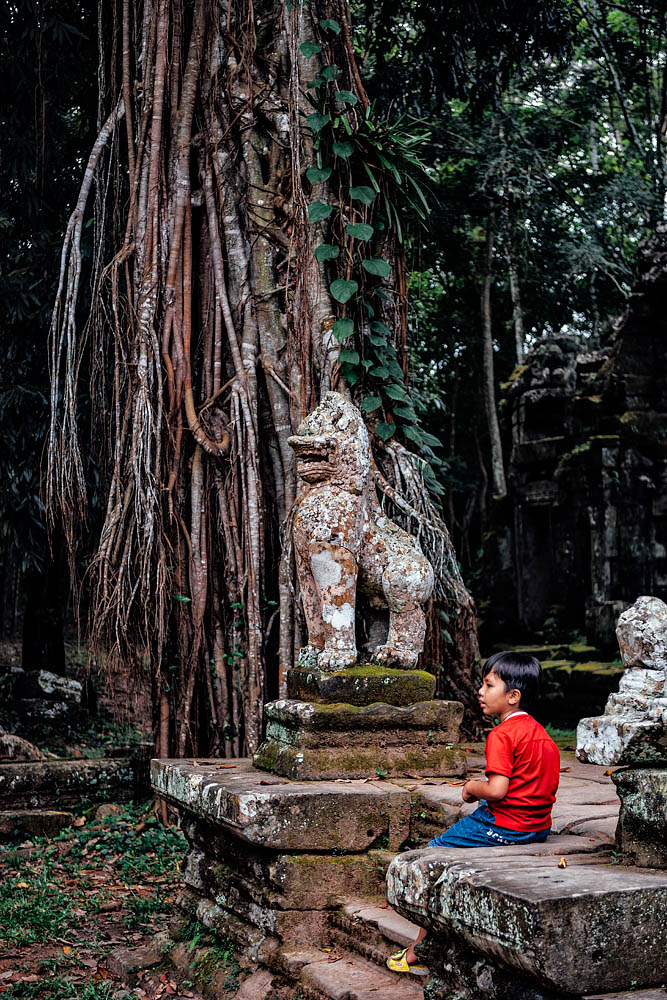 A child in the temple of Preah Khan