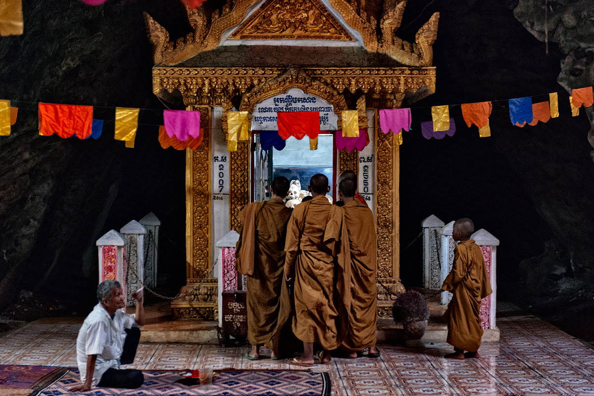 Monks in front of a ossuary
