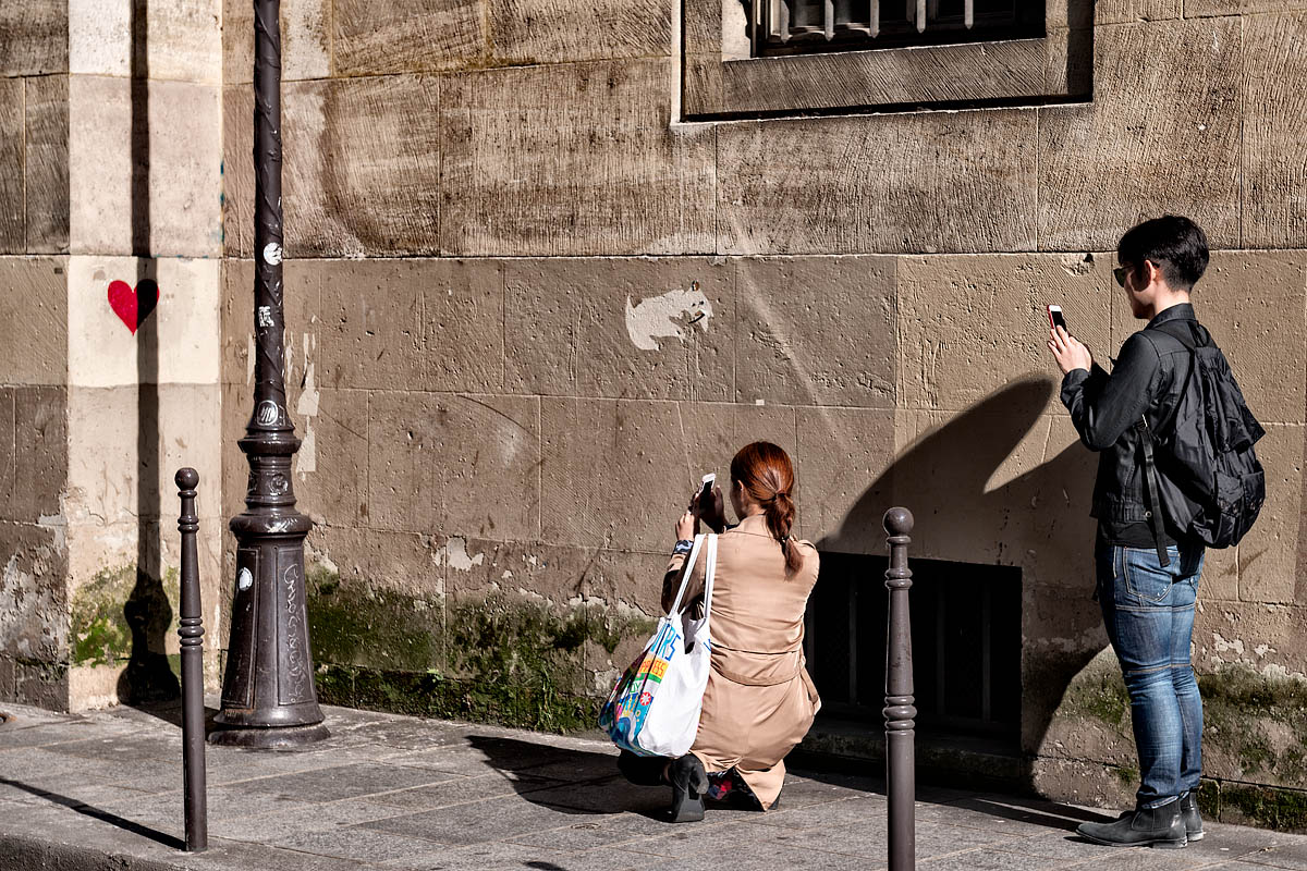People photographing a drawn heart in the wall, Paris, France 2016