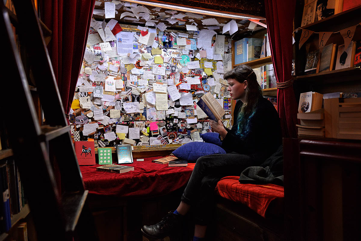 A girl reading in the Shakespeare and Company library