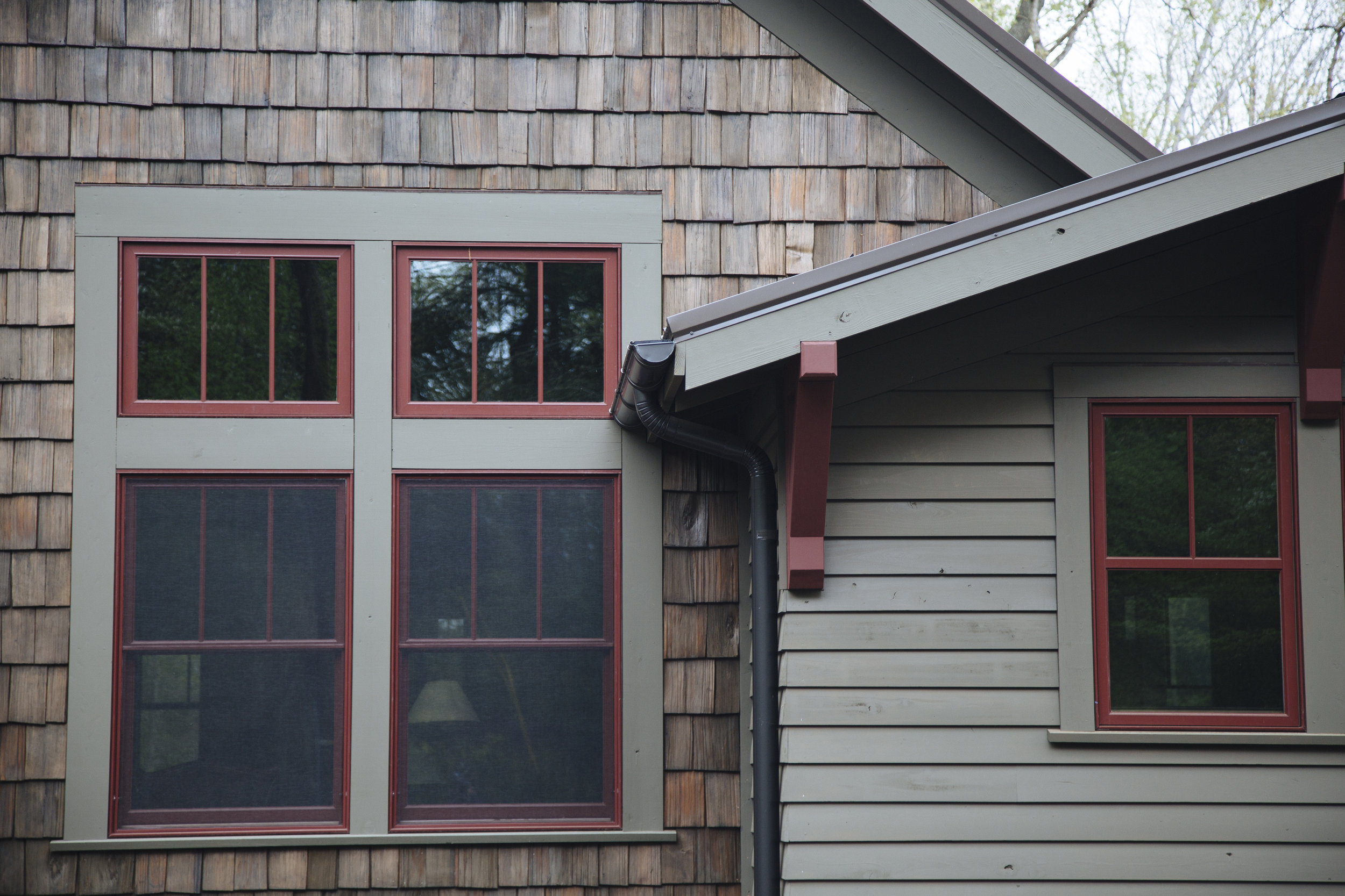 Green Home with Half-Round Gutters and Round Downspouts