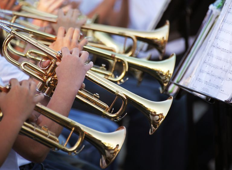 multiple-trumpet-players-reading-sheet-music-154968184-583d0d423df78c6f6a559d2c.jpg