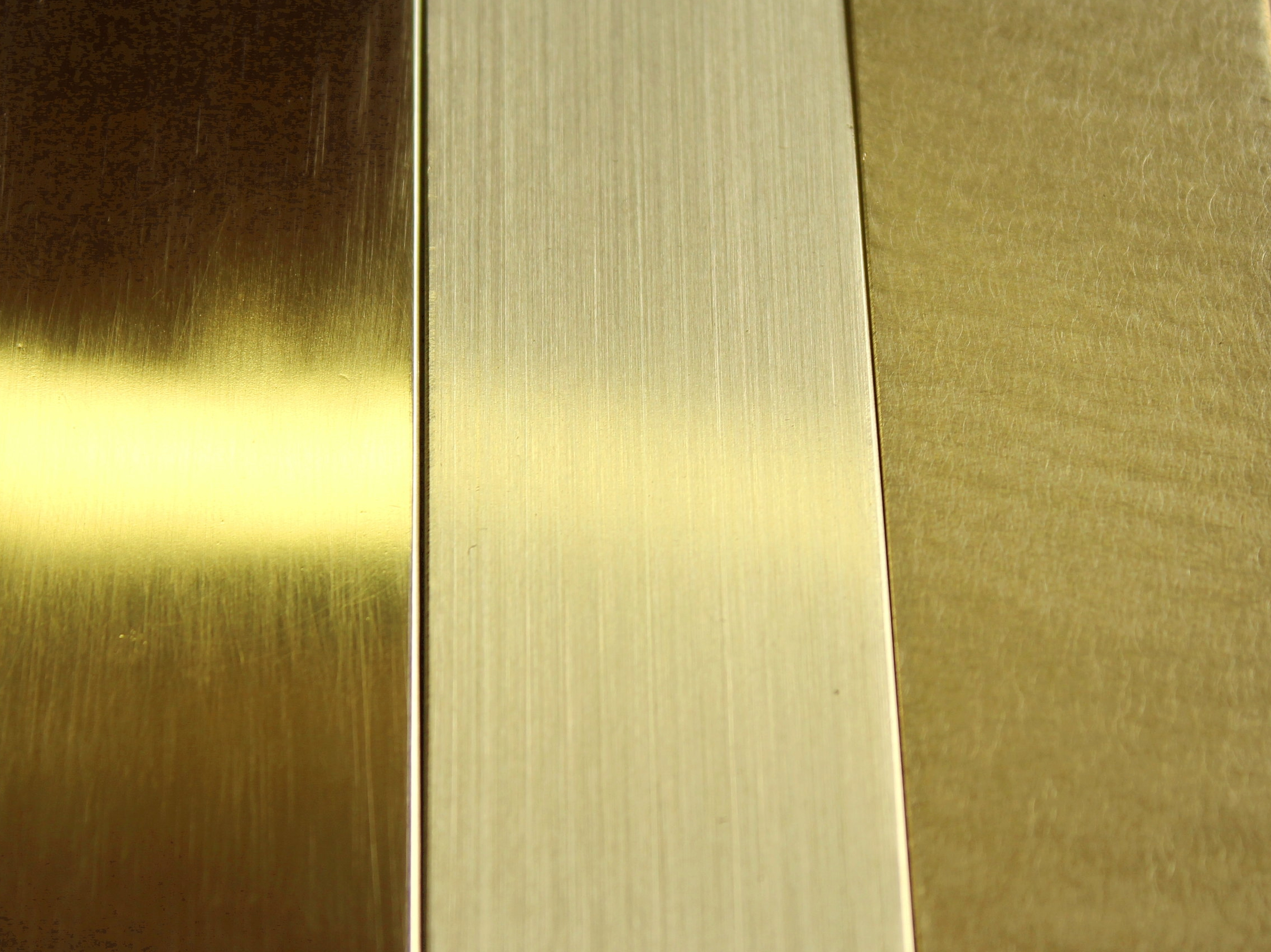 This is the same material with 3 different natural finishes.