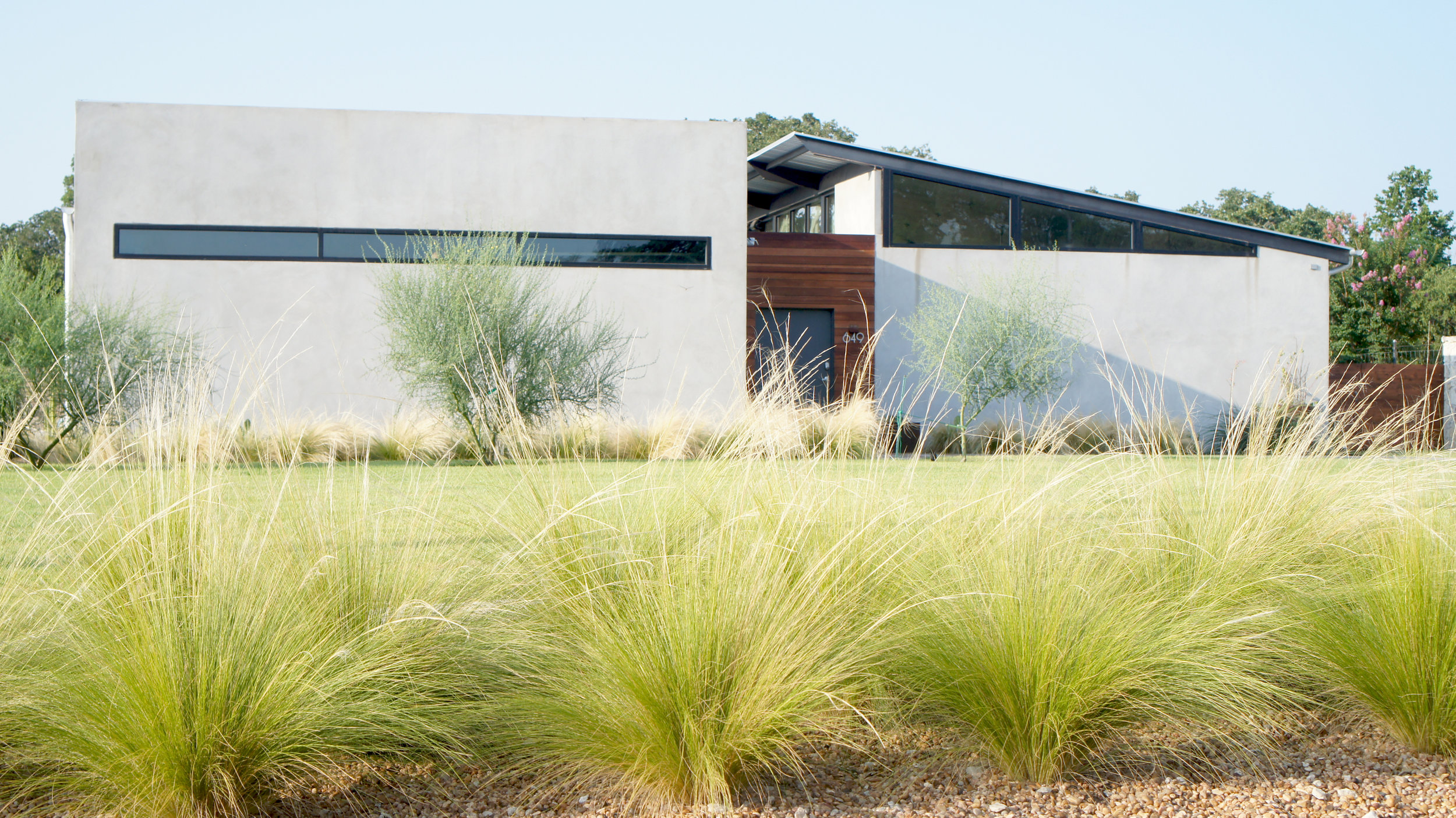industrial modern + glass house + hill country interior designer.jpg