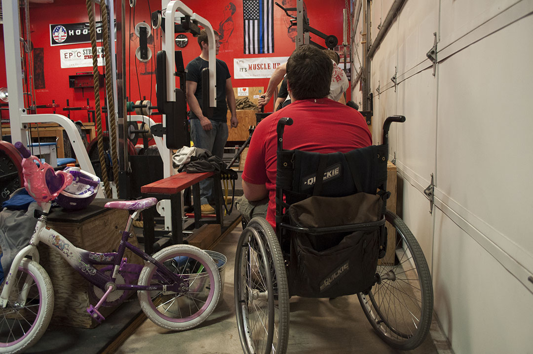 "Jeremy ""The Hammer"" Hammett watches his fellow armwrestling teammates practice ""pulling"" in their training facility, Epic Fitness Solutions, located in East Springfield.  The Willamette Valley High Rollers meet on Wednesday evenings to train, strategize, and plan for upcoming competitions."