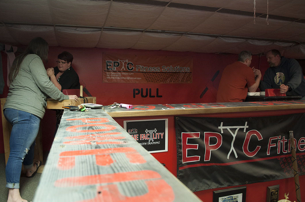 WVHR teammates practice in the gym's loft, which houses three armwrestling tables.  Specifically designed for armwrestling, the leather-topped tables are 40 inches tall and have two elbow pads and two touch pads, each made of high-density foam. Two 6-inch pegs serve as grips for stability.