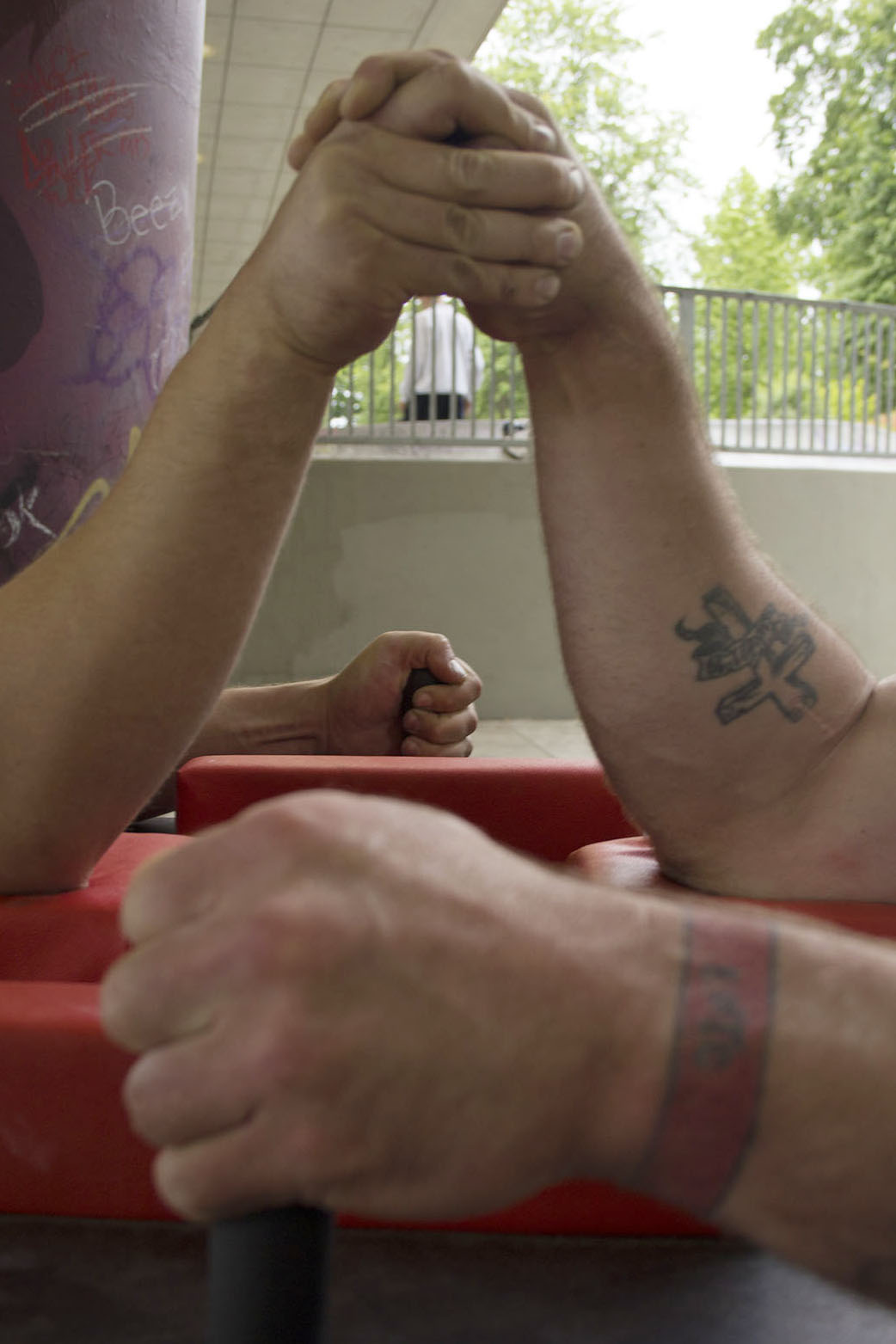 Hand positioning is an important part of armwrestling.  Though there are three basic moves: top-roll, hook, and press, competitors use various combinations and hybrids, often switching between moves in a single match.