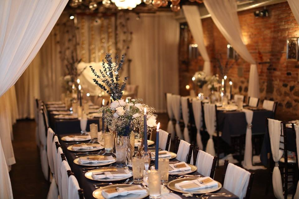 For the reception, we flipped the room with navy linens, navy candlesticks and floral cluster centerpieces, creating a soft, candlelit look.