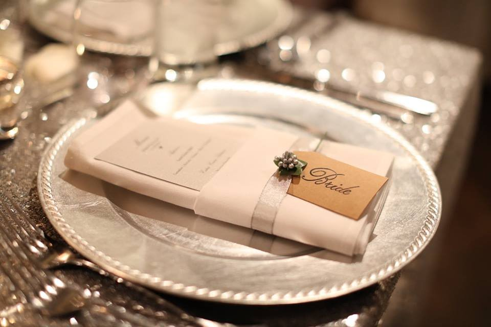 Place settings welcomed guests with unique name tags and menus.