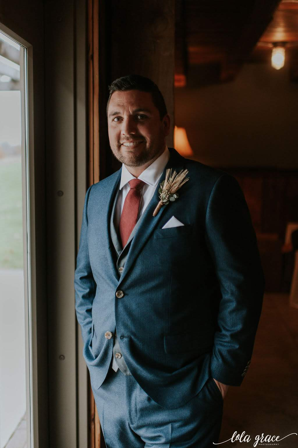 The perfect fall suit and boutonniere combo for this handsome groom.