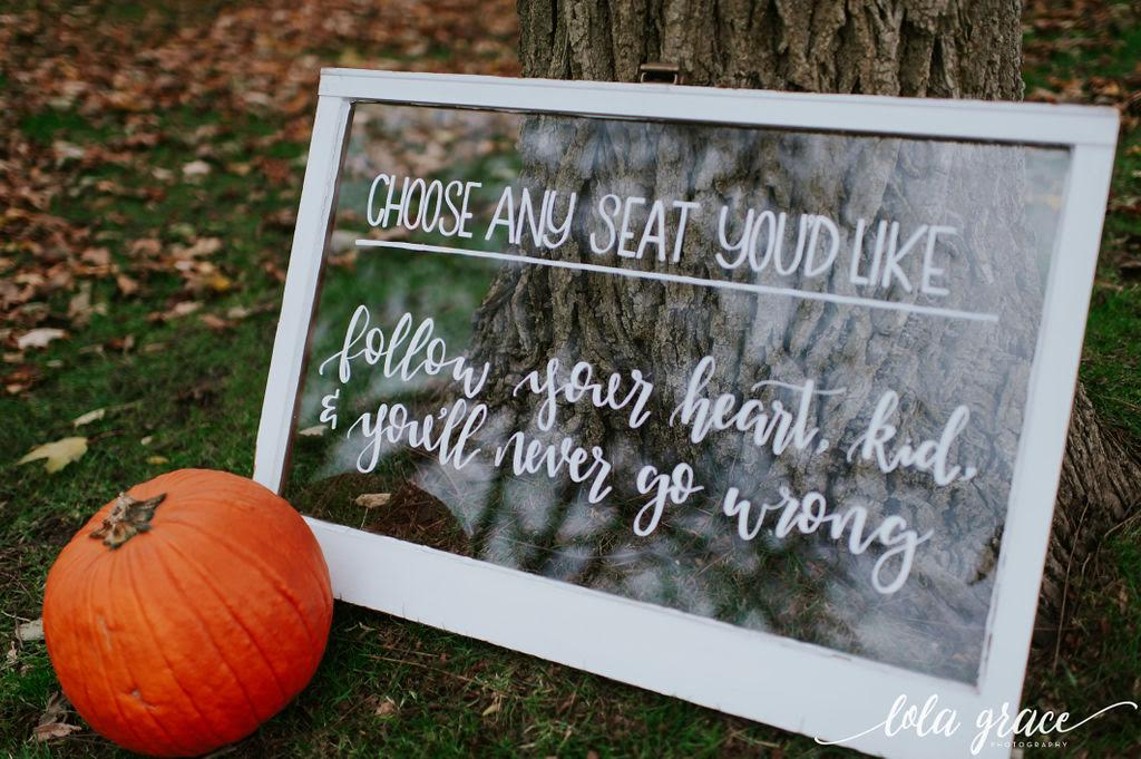 """Paul and Michelle wanted to include one of their favorite quotes from """"The Sandlot"""" on their ceremony sign made by  Mitten Script by Marah ."""