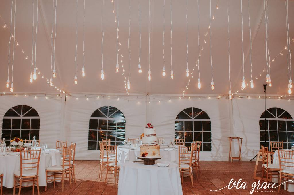 The Edison bulbs lighting installation highlighted Paul and Michelle's wedding cake.