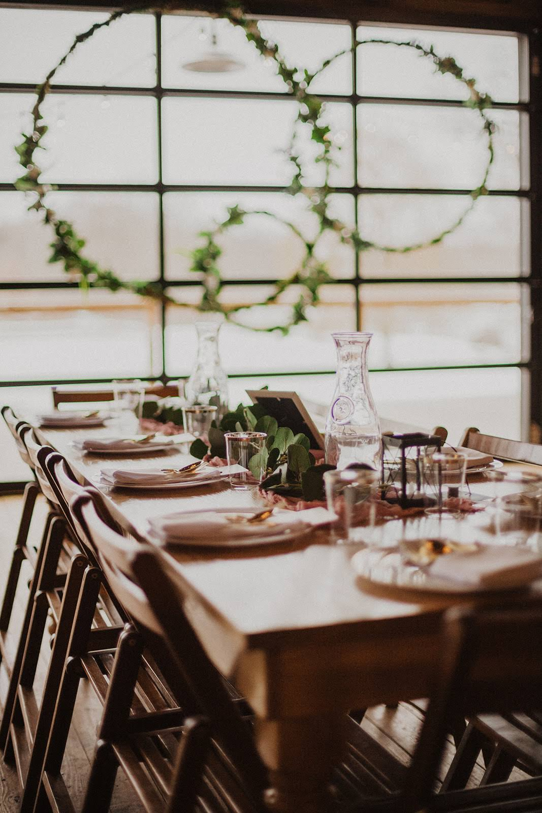 Tables were accented with gold silverware, mauve runners and eucalyptus garlands.