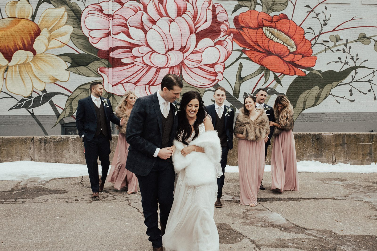 Murals in downtown Jackson provided such a backdrop for their bridal party pictures.
