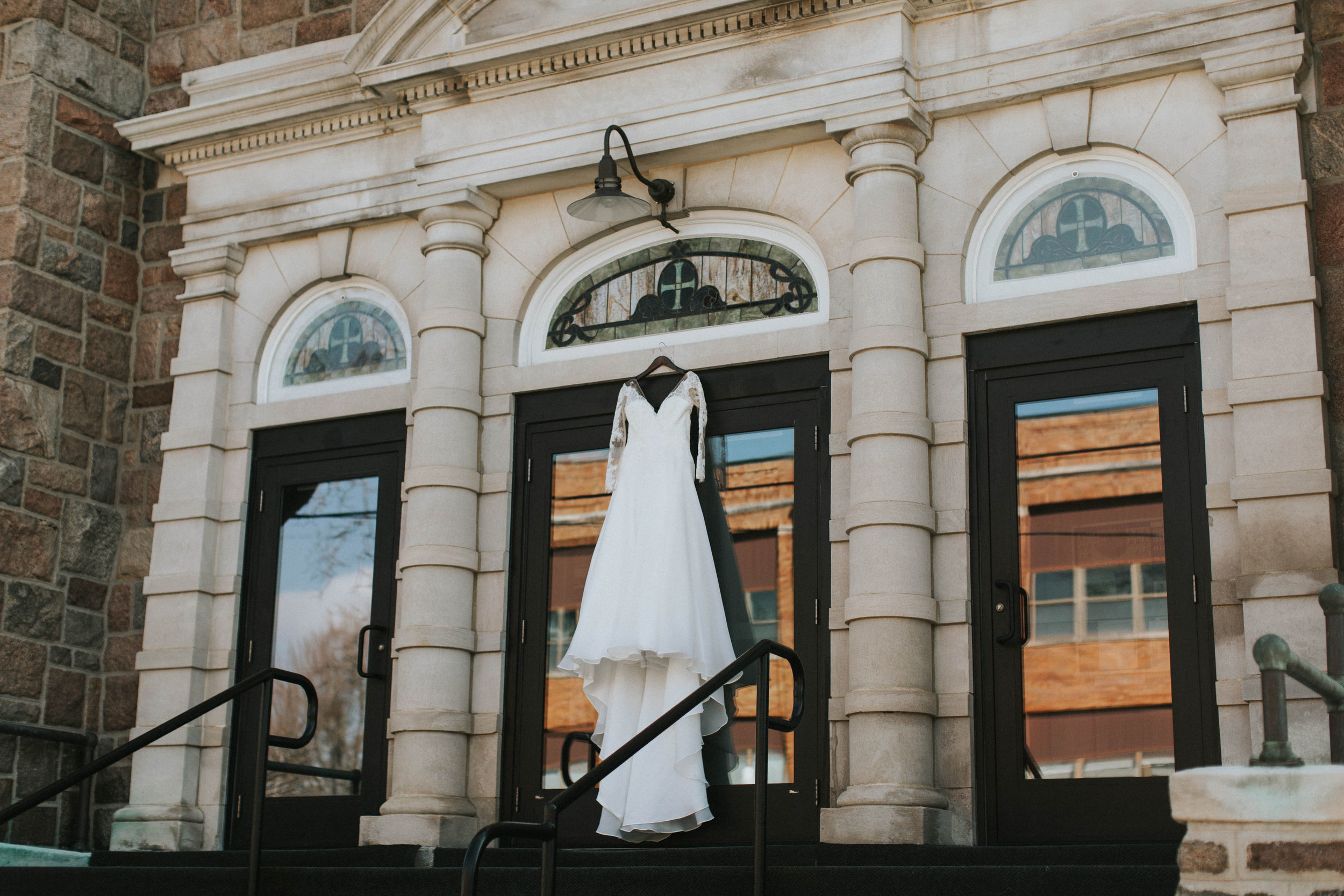 How gorgeous is her dress hanging in front of the church?