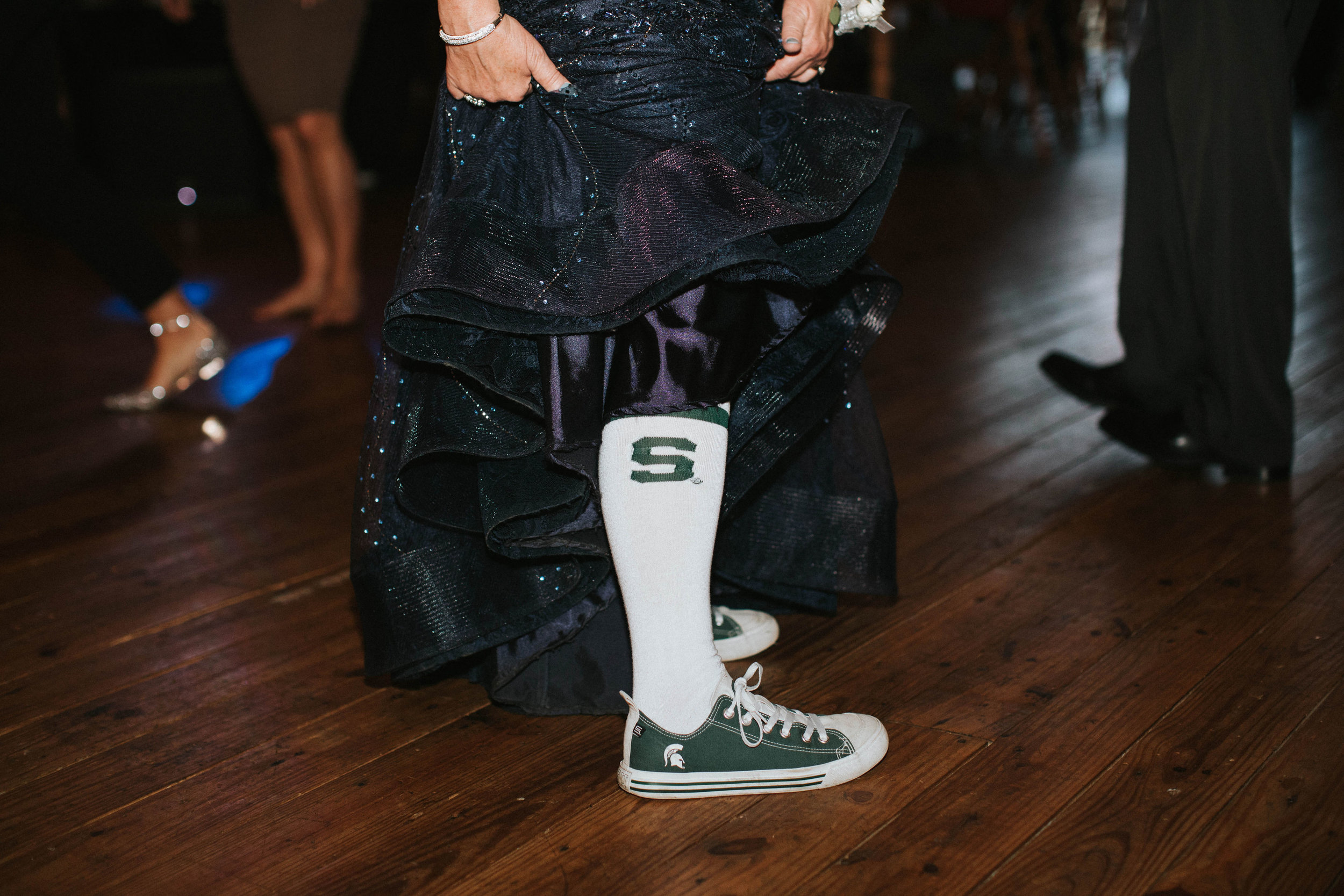 The mother of the groom busted our her MSU sneakers and socks for dancing!