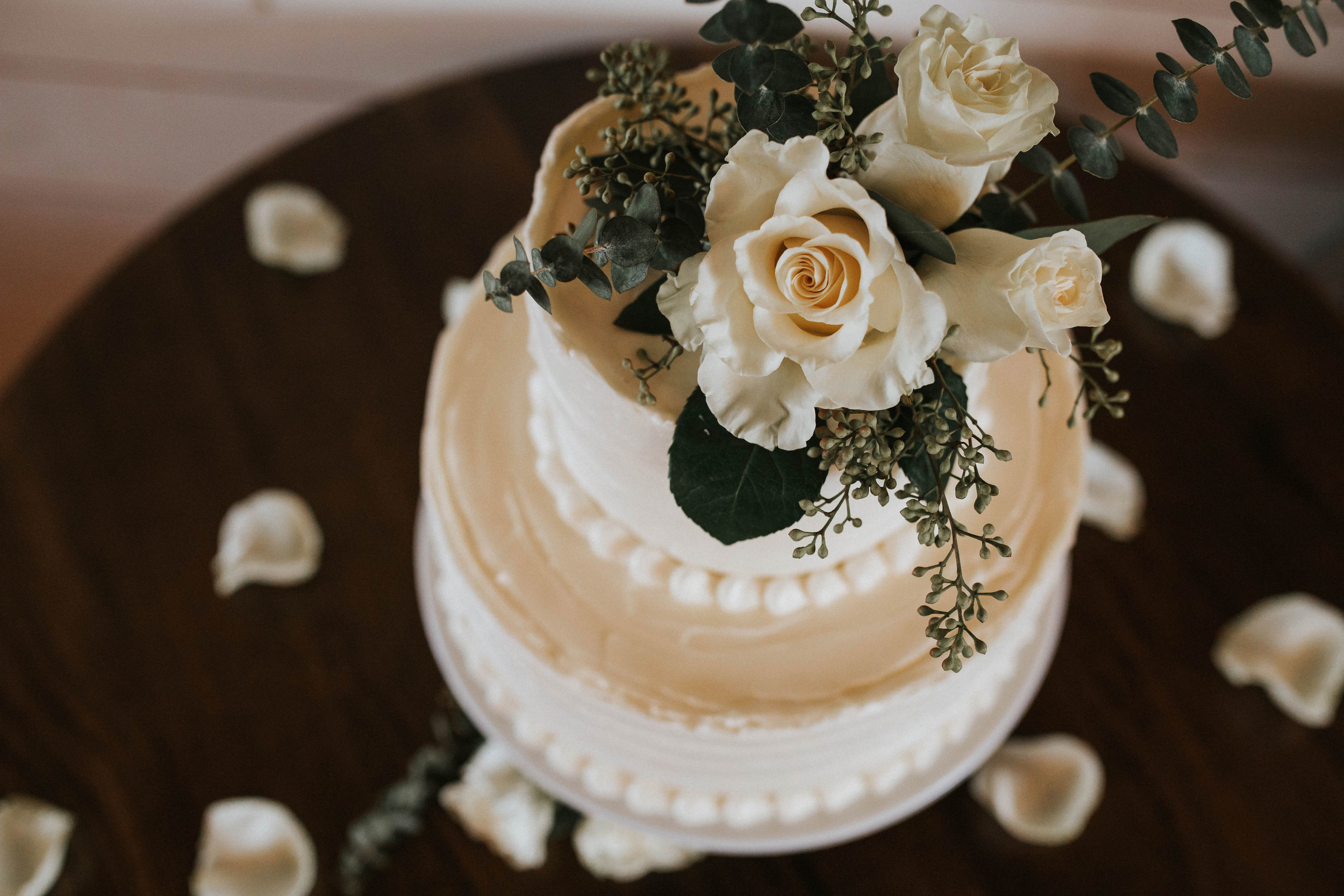 Coordinating florals embellished their couple's cake and added just the right amount of texture.