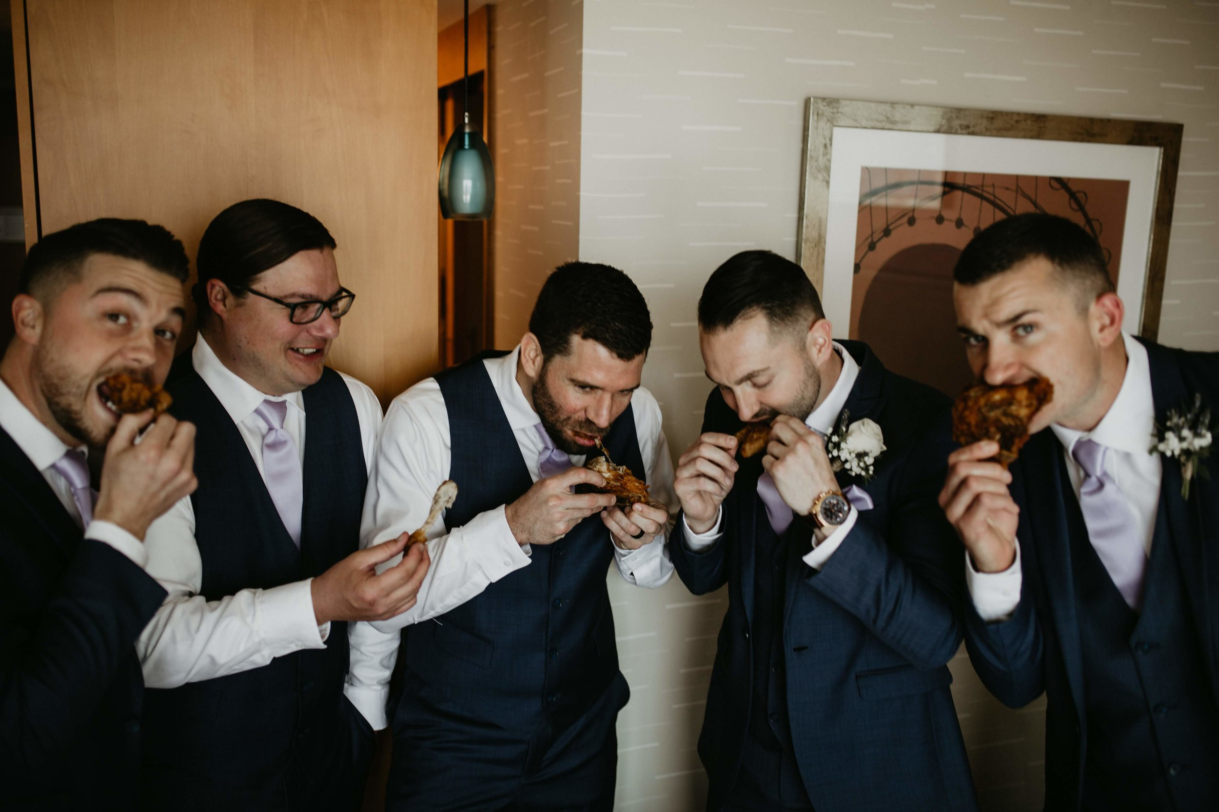 Sustenance is key on your wedding day, probably the most stylish they have ever looked eating wings!
