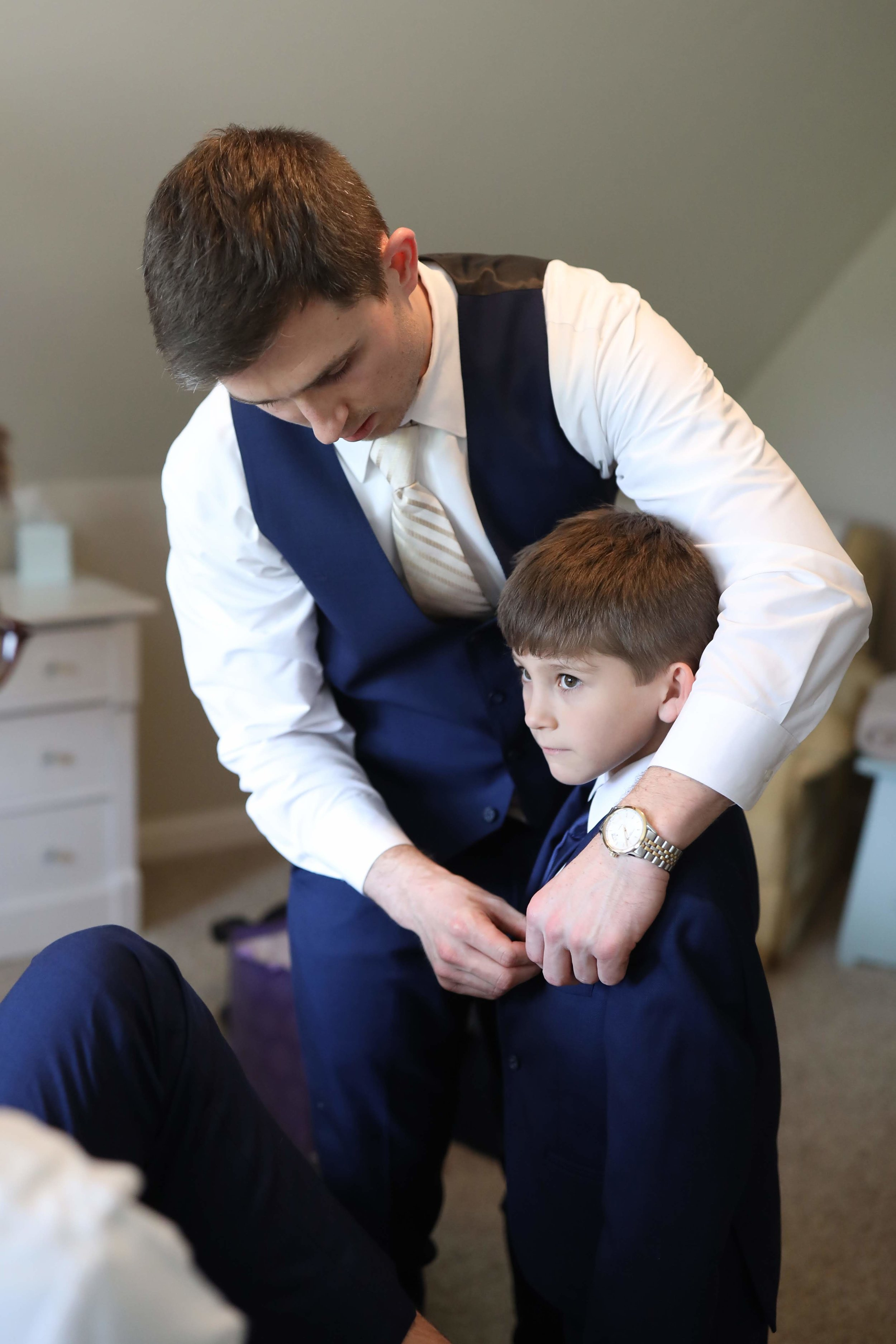 Henry helping their son, Easton, get ready for the big day.