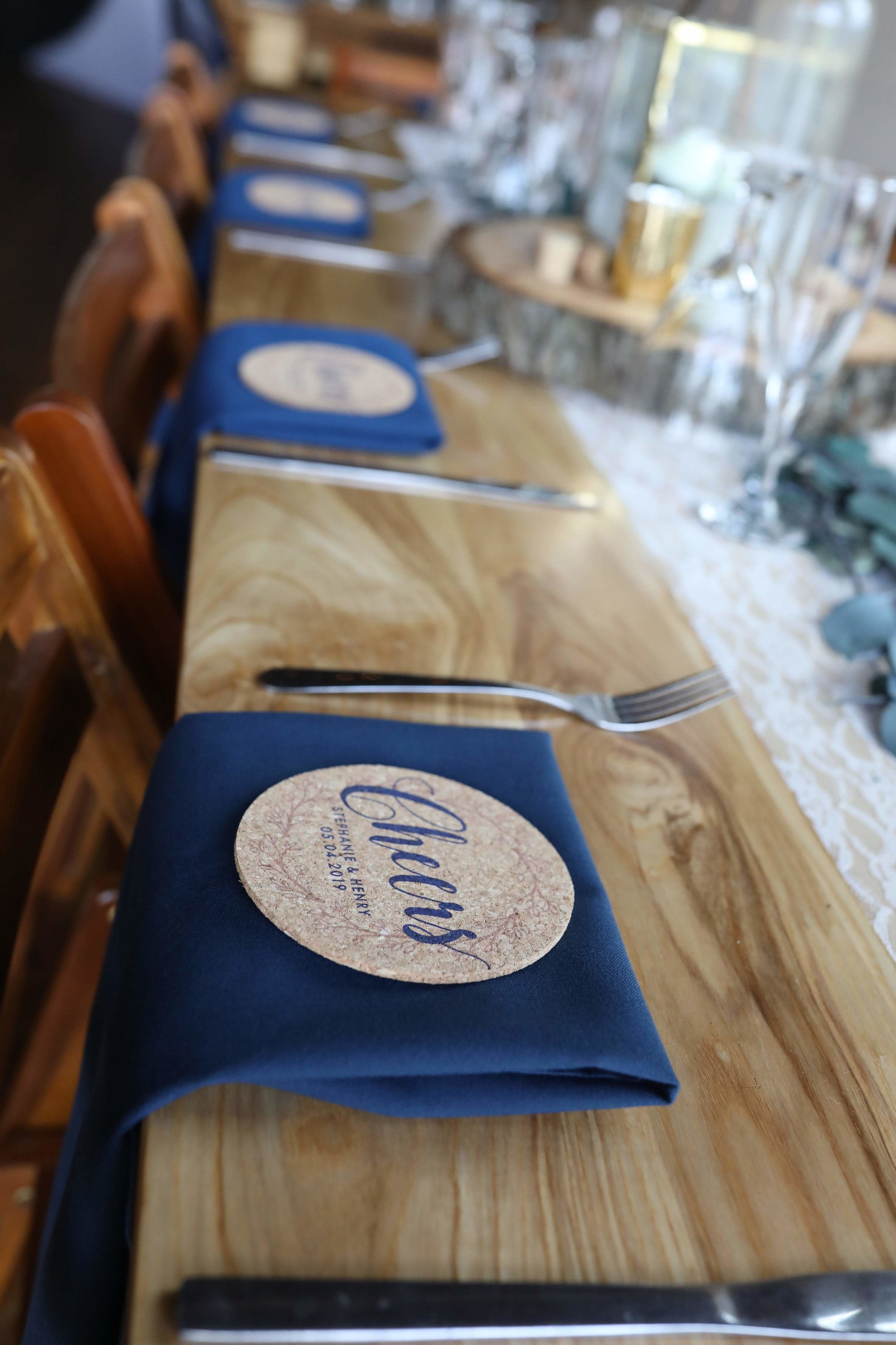 Custom cork coaster favors accented their navy linen napkins at each place setting.