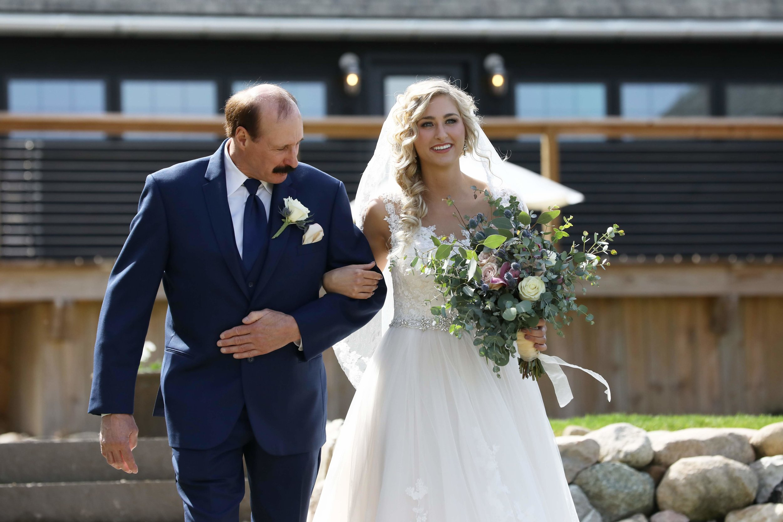 Stephanie surprised Henry with a meaningful song when she walked down the aisle.