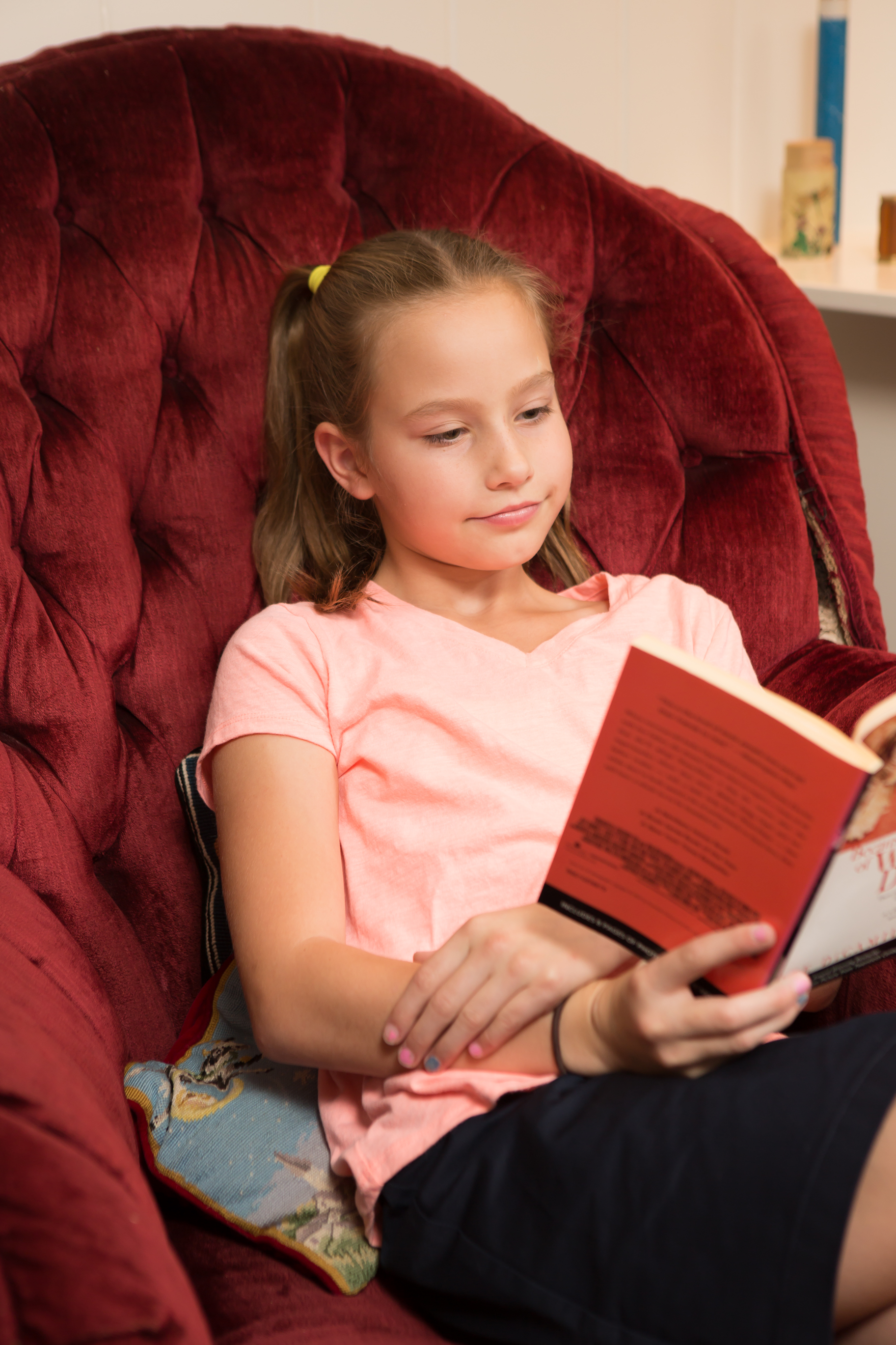 Young Girl Reading At Tutor Session