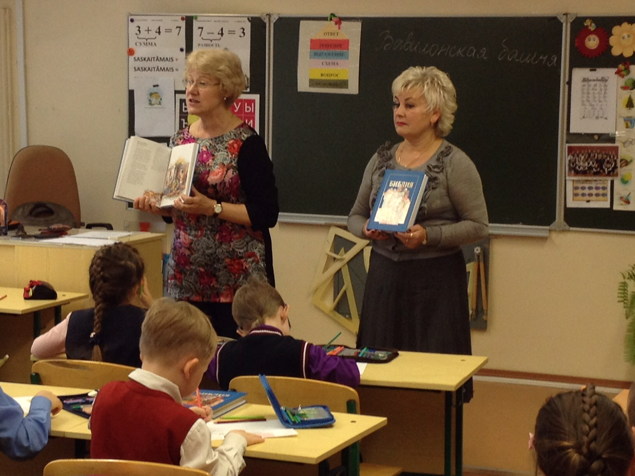 Dr. Olga assists a teacher in a classroom in Samara, Russia