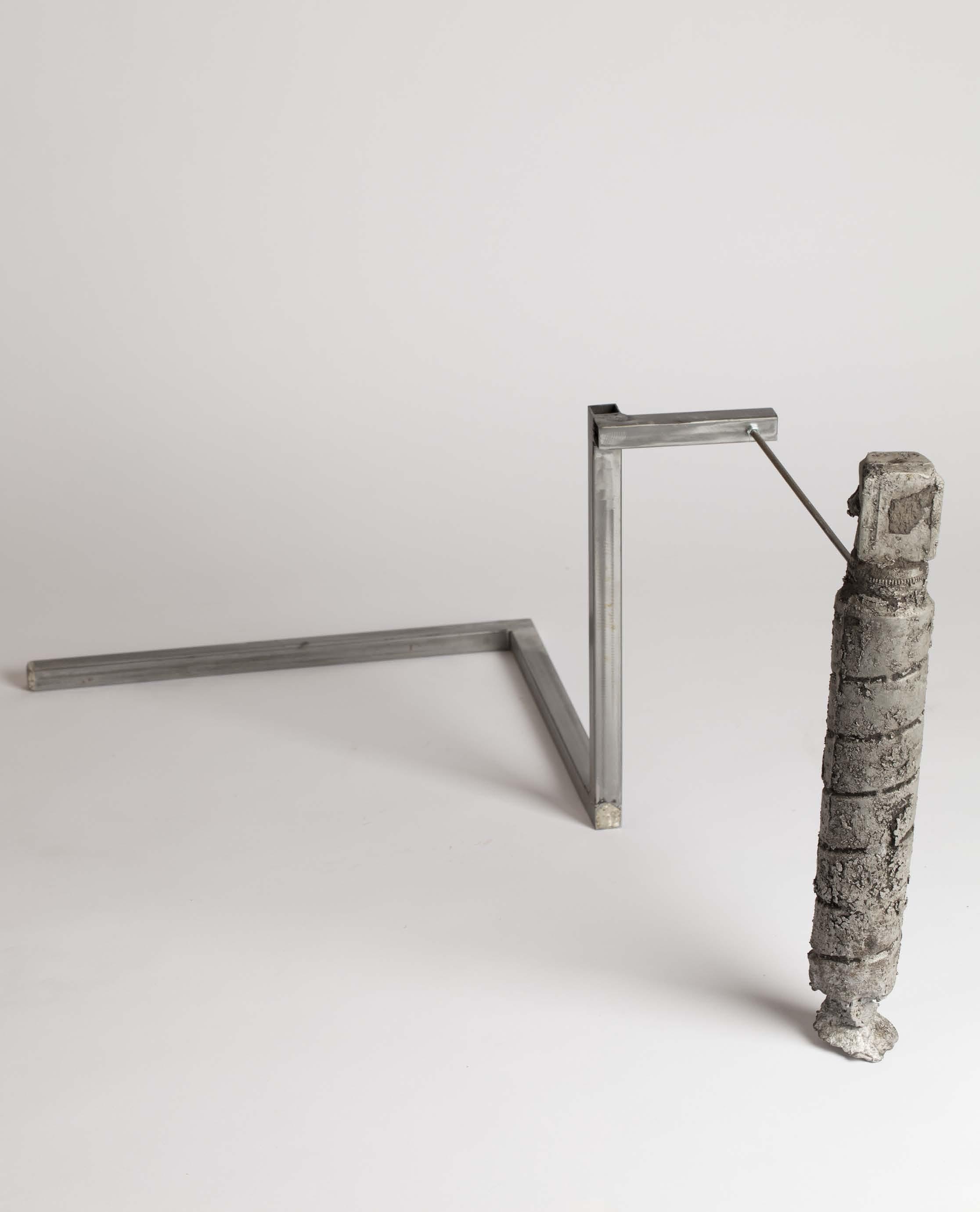 Jules Dumoulin,  Sticky toner , 2018,  Toner d'imprimante moulé puis tiré en aluminium, sup- port d'acier lesté de béton. 60x40x39cm