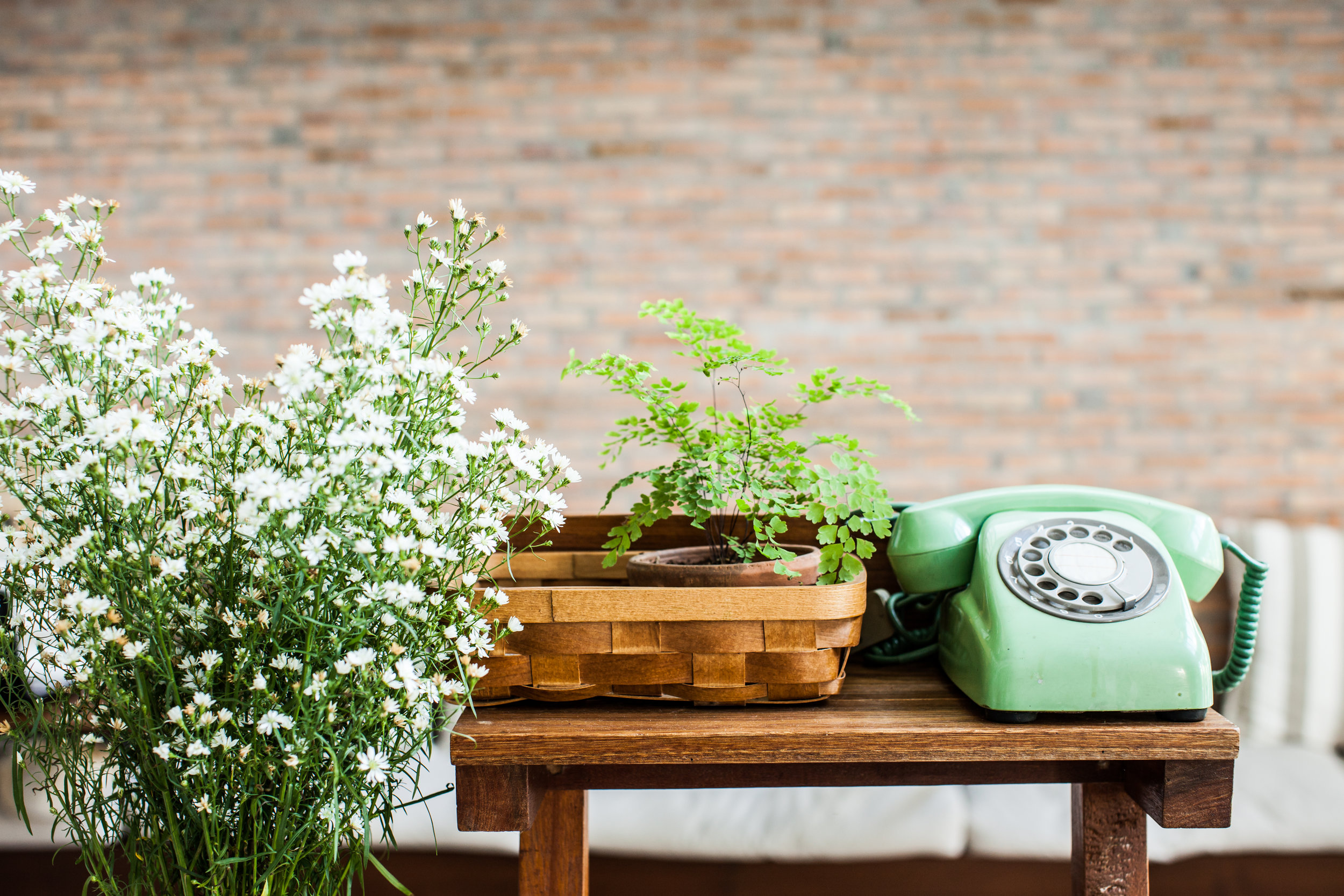 stock-photo-retro-mint-green-rotary-telephone-on-wood-table-225618496.jpg
