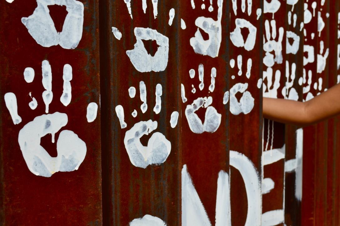 hand prints that have been painted on the Mexico side of the wall. On the US side, I.c.e. removes such things.