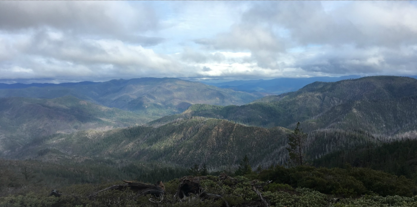 The wild Kalmiopsis, looking west toward 2018 summer fires and the coast. Photo by Brodia Minter