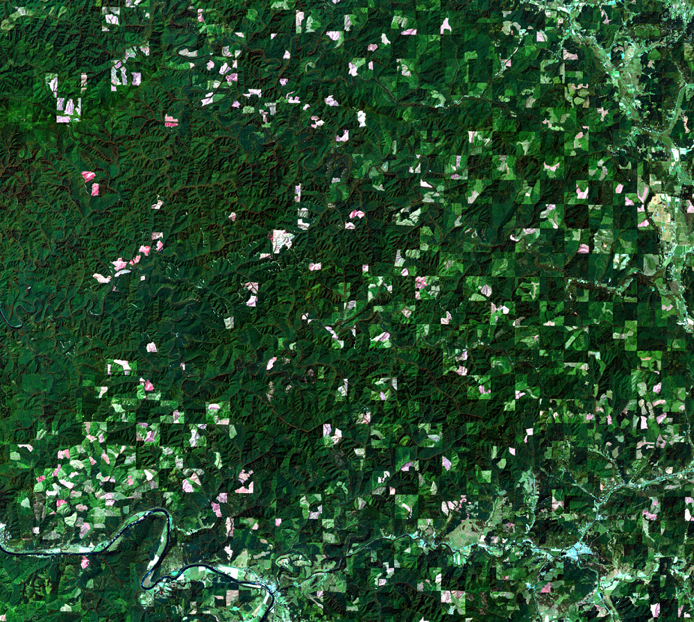 The checkerboard land ownership pattern as it appears from satellite, USGS