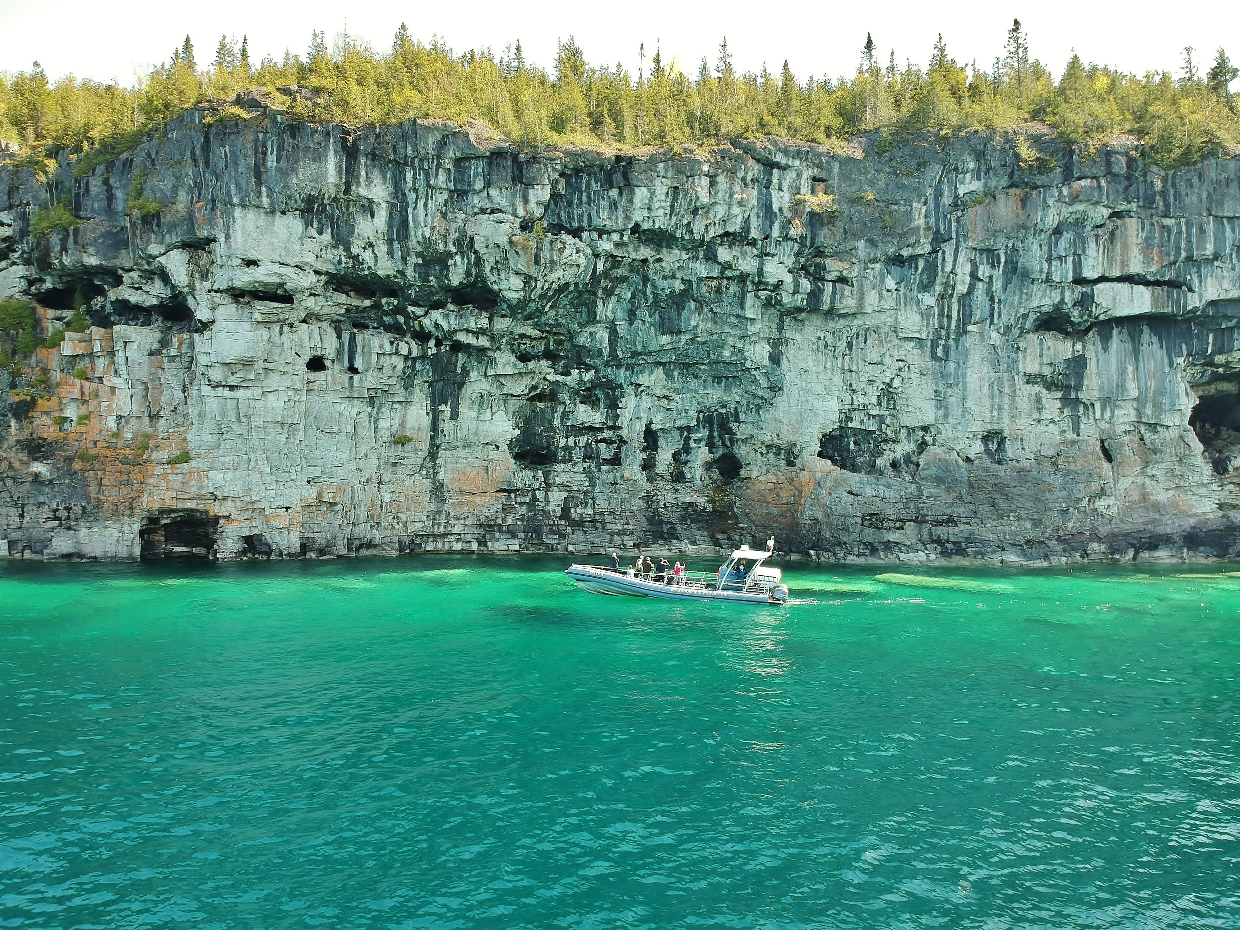 Deluxe Wave Tour - Our classic cliffs and caves tour but longer. Do you want to experience more of the National Park than anyone else? See several destinations like Flowerpot Island, The Grotto and spectacular Cave Point on this exclusive 3 hour guided tour. Private tour option. Cancellation & fine print.Adults $57 - Seniors $54 - Child $50