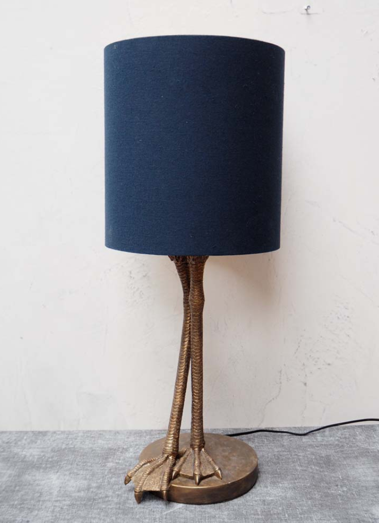 Heron legs lamp with shade A talking piece, this quirky lamp is designed with long heron legs and webbed feet as its base. £178.