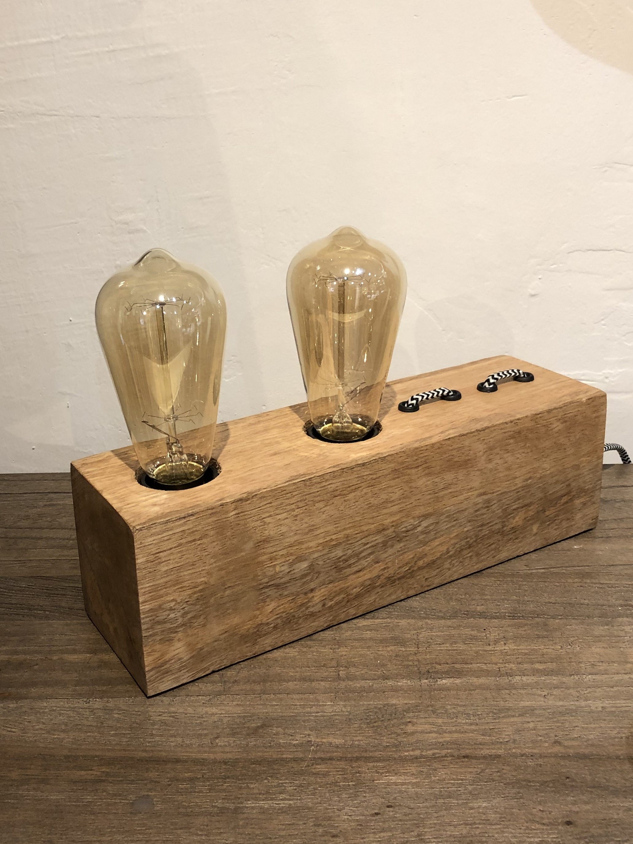 Block light A simple design that looks great in a rustic or industrial interior. A block of wood with retro black and white cabling takes two bulbs. Also available as a single light. £58