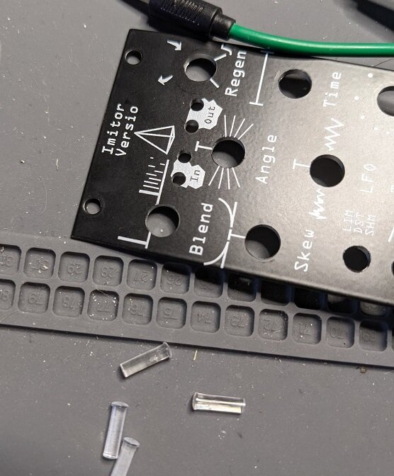 To install them on the new panel, gently press them into the front until they feel snug.