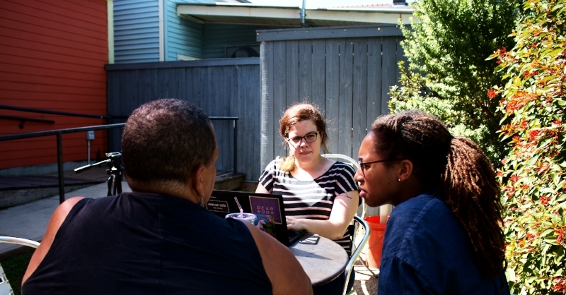 Jana King (middle) talks with Camille Stelly, right, and Amy Stelly, left