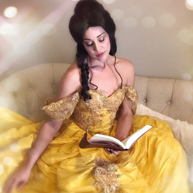 With a dreamy far off look, and her nose stuck in a book 📚✨ (855)PIXIECO PixieDustCo.com #beauty #beautyandthebeast #belle #cosplay #cosplayer #cosplaygirl #ballgown #bookworm #colorado #coloradosprings #coloradolife #professionalprincess #princess #partyprincess #princessparty #coloradoliving #actorslife