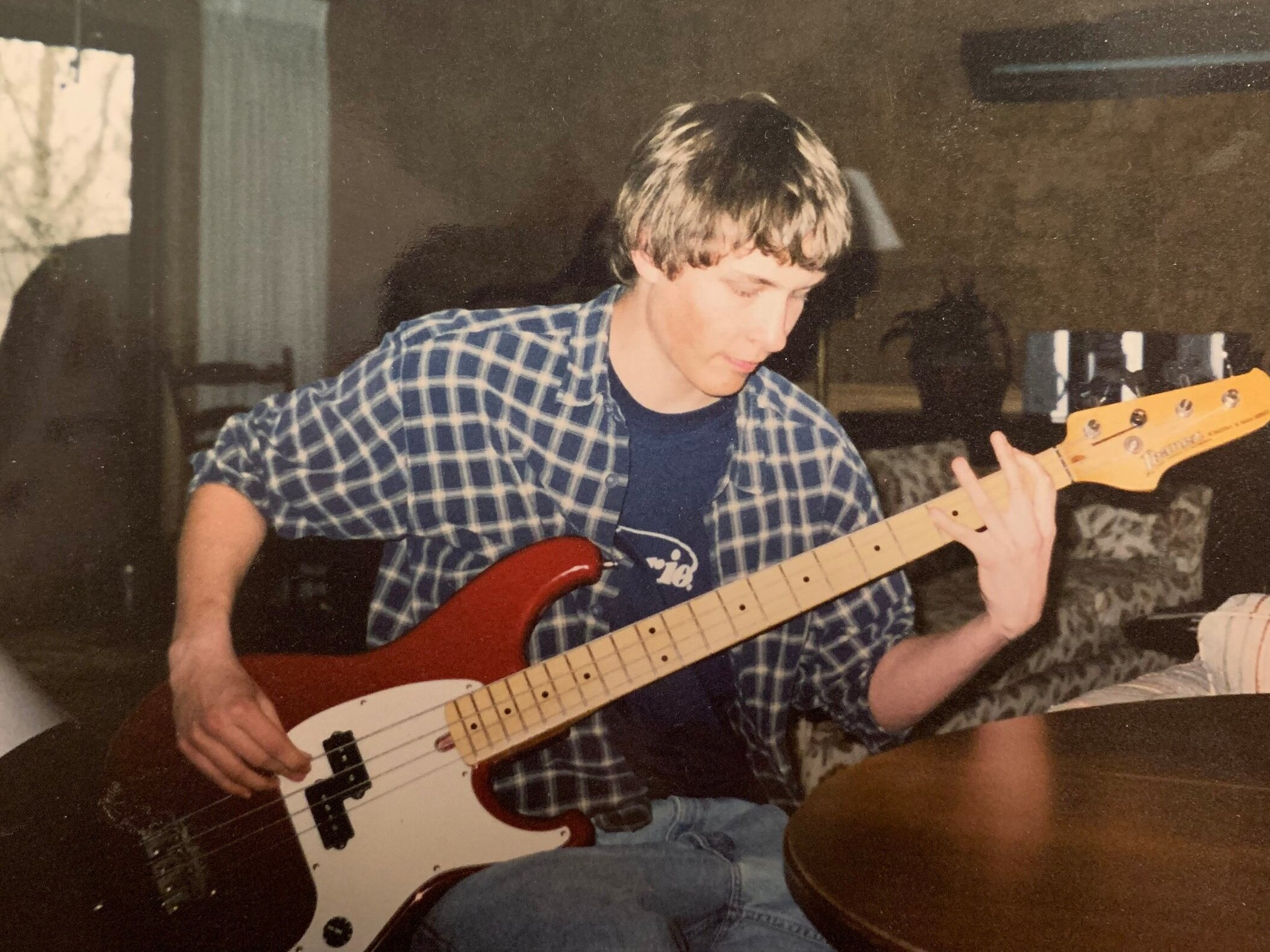Playing bass at the grandparent's house in 2003. 16 years ago!