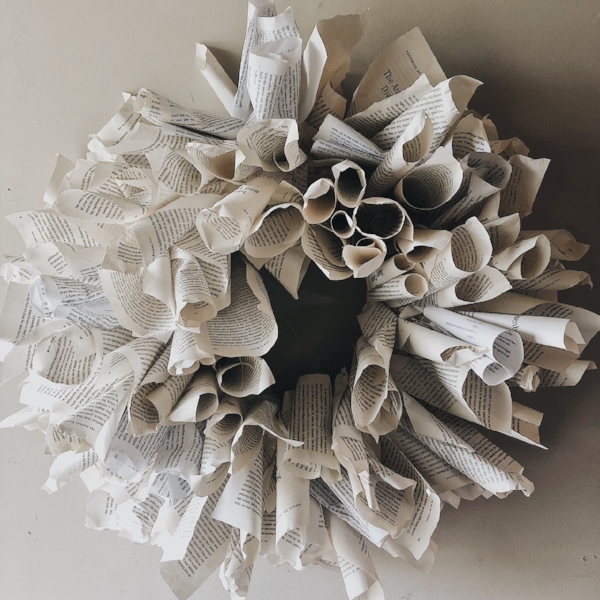 Close up view of book page wreath.