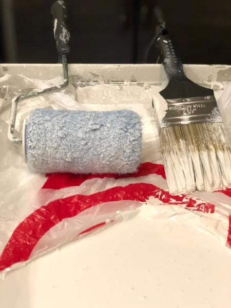 Money and time saver tip: Reuse a store plastic sack to line your paint tray. Prevents having to wash tray between coats and free.