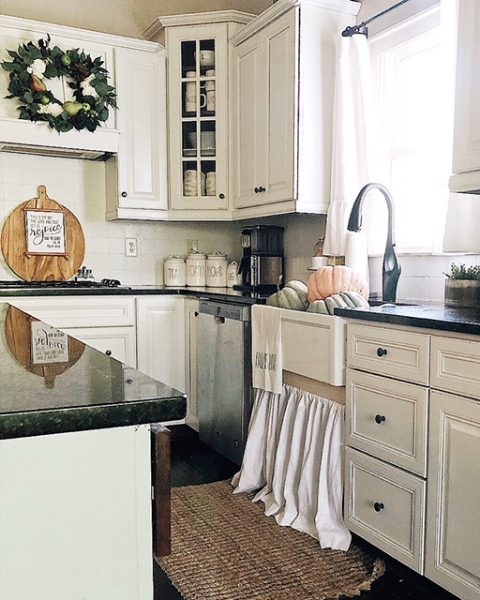kitchen view with farmhouse sink full of pumpkins