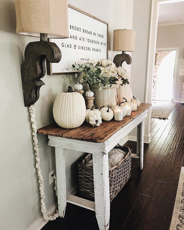 "Happy Wednesday night friends😆! Played around with some pumpkins in this space today, and planning to add some color in as we move towards the fall months! Decorating can be a game of musical chairs at times, trying things out and seeing how it ""feels"" after a couple of days. Anyone else do this?! This is more representative of a transition into fall from a summer look I'm thinking, haha! What do you think?  Speaking of fall decor, I shared a fun fall DIY over on my stories that I'd love for you to go check out. I plan on answering some of the questions you all have had about it and just fall decor and diys in general tomorrow on my stories!  PS: the amazing candles there are my fall favorites and are linked in my stories! Or you can tap link in profile too! And, the sign is by @the.little.bird and corbel wall lamps are also linked in profile!  Wishing you each a beautiful night friends! Grateful for you🙌🏻💗! #farmhousestyle #farmhousedecor #rustic #homesweethome #antiquefarmhouse #corbels #diningroom #fixerupper #fall #falldecor #diningroom #diningroomdecor #neutraldecor #antique #vintage #rusticdecor #rustic #cottage #cottagestyle #autumn #countrylivingmag #bhghome #seasonaldecor #pumpkins #homesweethome #shabbychic #countryliving #diy #farmhouse"