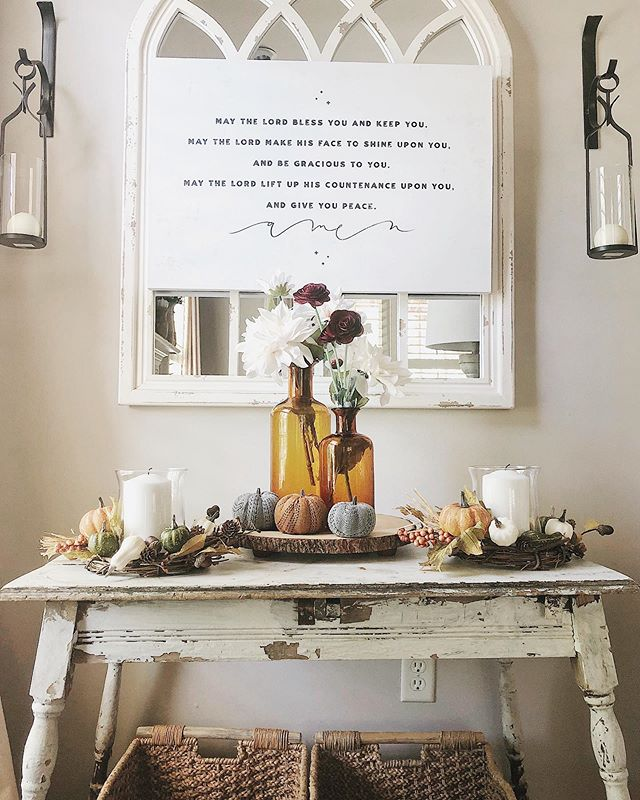 Happy Thursday evening friends!  This little table got moved to a new place when we put our house on the market, as it used to be in our entryway. It got a few little fall touches today😆🍁... But I mist excited to share with y'all the canvas hanging on top of the mirror ...it is from @farmhousecanvas.co and I love it! When I first saw it I knew it was the perfect piece for our home... My grandfather pastored a local church here in #birminghamalabama for 36 years and this was the benediction he so often used all those years.  When my mother was over here the other day, she saw it and smiled bc it was her fathers voice that she recalled saying these beautiful words. There are not many days that go by that my husband and I don't recall something he would speak or wisdom he'd share with us. Love having this as a reminder of him in our home🧡🧡. Love the @farmhousecanvas.co line! Go check them all out friends, you'll love their pieces🙌🏻!!! wishing you all a beautiful and blessed night friends!  #farmhousestyle #farmhousedecor #rustic #homesweethome #shopsmall #corbels #diningroom #fixerupper #fall #falldecor #diningroom #diningroomdecor #neutraldecor #antique #vintage #rusticdecor #rustic #cottage #cottagestyle #autumn #countrylivingmag #bhghome #seasonaldecor #pumpkins #homesweethome #shabbychic #countryliving #diy #farmhouse