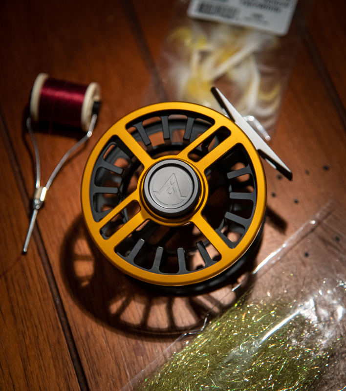 The Alpen X featuring a black spool on a Burnt Orange reel.  FIRE