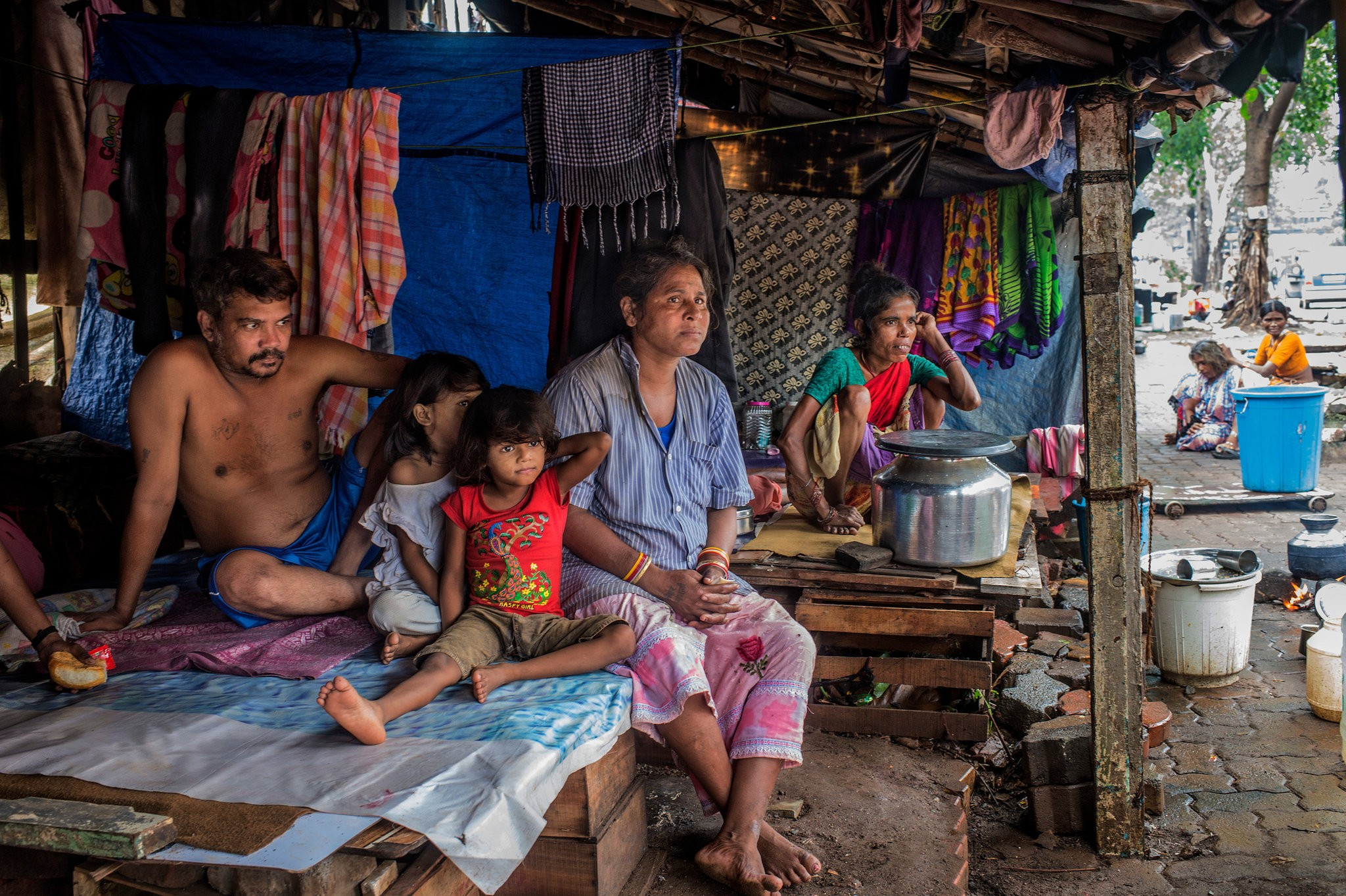 """Suraj and Babli Dhurve with their chldren in their shelter in Mumbai. Every summer when the monsoon hits, the family's home is flooded."" (Atul Loke 