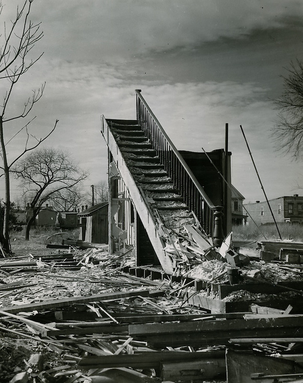 """Above: """"Stairway to the Stars."""" 1953 Redevelopment Project. Olney Road W of Cooke Street. (Photo: NRHA).  Below: Young Park Demolition. Undated. (Photo: NRHA)."""